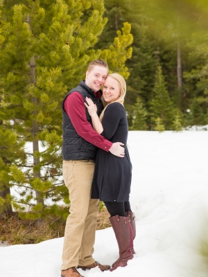 Bozeman Engagement Session - Couple standing in snow in Hyalite canyon on winter day