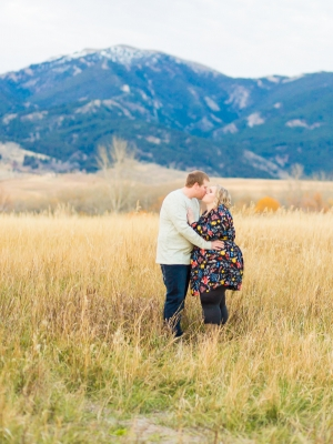 Bozeman Engagement Session - Couple standing in tall grass in front of Hyalite mountains