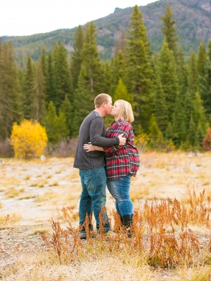 Bozeman Engagement Session - Couple wrapped up close at base of Hyalite Canyon