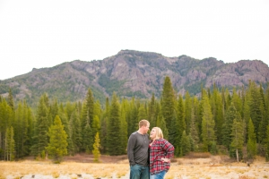 Bozeman Engagement Session - Hyalite Canyon couple wrapped up in front of fall colors
