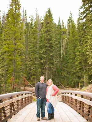 Bozeman Engagement Session in Langhor Campground - Couple standing on Bridge