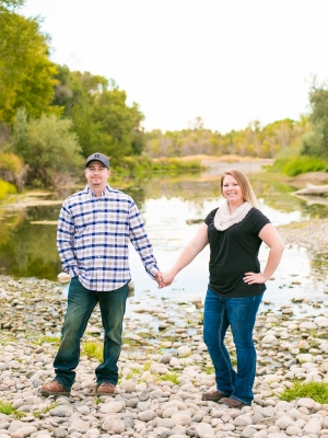 Billings Engagement Session - Couple standing in Riverfront Park next to river