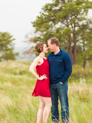 Billings Engagement Session - Couple on Rims in red dress