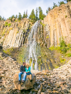 Bozeman Engagement Session in Hyalite Canyon - Couple standing in front of Palisade Falls