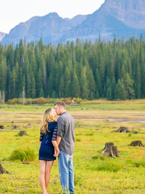 Hyalite Engagement Session in Bozeman Montana - Couple standing in emptied reservoir in front of Hyalite Mountain
