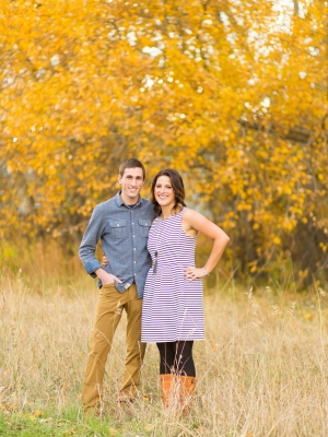 Bozeman Engagement Session - Couple walking in front of Bridger Mountains base