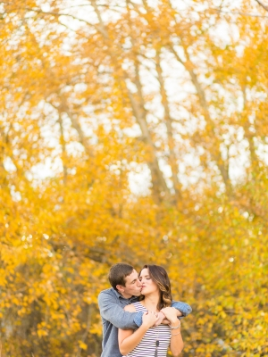 Downtown Bozeman Engagement Session - Standing at in front of fall soaked trees