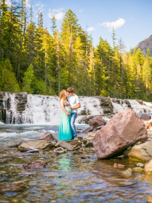 Glacier National Park Engagement Session - Couple in front of waterfall