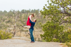 Billings Engagement Session on the Rims - Couple standing on cliffs at sunset