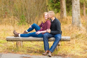 Bozeman Engagement Session in Hyalite Canyon - Couple on park bench