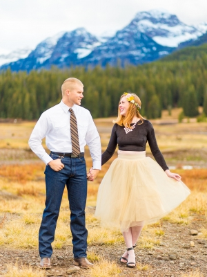 Bozeman Engagement Session - Couple in front of mountain range with flower crown and tool dress.