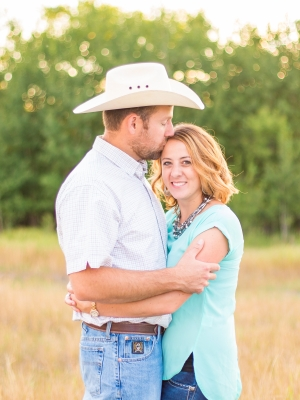 Bozeman Engagement Session - Couple holding each other close with cowboy hat