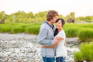 Billings Engagement Session - Couple standing in Riverfront Park in front of river