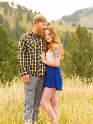 Havre Engagement Session - Couple hiking through mountain canyon at sunrise