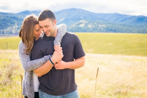 Red Lodge Engagement Session - Couple standing in front of Absorkee Mountain Range