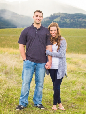 Missoula Engagement Session - Couple posed in front of mountains